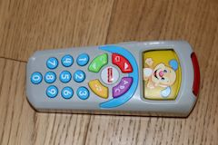 Family Road Trip Activity Ideas For In The Car - toys that make noise and light up help distract babies and preschool age children if getting fussy. Small toys are easiest to travel with like the Fisher Price TV remote control