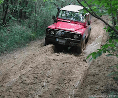 Land Rover Defender battling mud